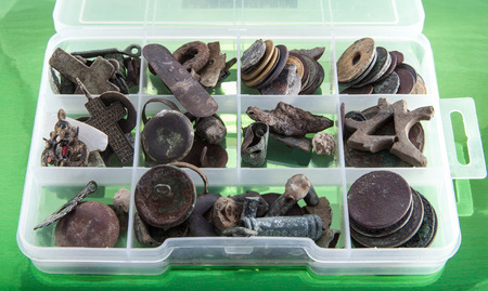 finds: archaeologist finds a box with old metal objects to determine