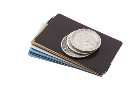 non cash: old silver coins are on the new credit card