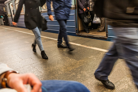 degradation: the arrived passengers of the subway hurry on change or an exit to the city