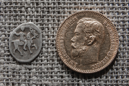 kopek: Evolution of the Russian money - silver Moscow kopek of Ivan Grozny and gold 5 rubles of Nikolay Romanov
