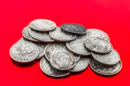 double headed eagle: silver coins with double headed eagle on the red background are
