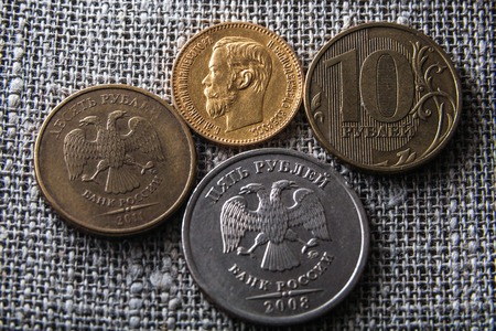 nickel: coins rubles, gold nineteenth century and nickel twenty first eyelid Stock Photo