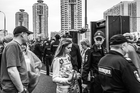 dishonest: Moscow, Russia - September 20, 2015: Meeting of protesting citizens in Moskovsky district of Maryino against dishonest elections and for removability of the power in Russia. The police checks all the people who came to peaceful meeting regarding the weapo