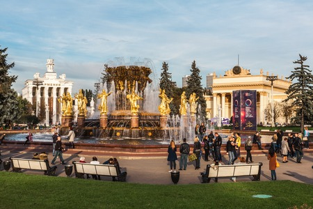 republics: Moscow, Russia - October 4, 2015: Part of the Exhibition Center VDNH (VVC). The Friendship of the People fountain. In an image of gold girls 15 republics of the USSR are stylized.