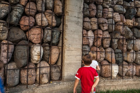 totalitarian: Moscow, Russia - September 25, 2015:  City artistic park Muzeon. Victims of totalitarian regime, author Chubarov. Fragment, children. Editorial