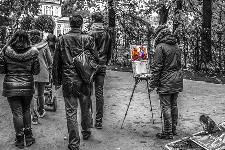 kuskovo: Moscow, Russia - October 17, 2015: Country estate of the count Pyotr Sheremetev in Kuskovo. The unknown painter draws a picture, without noticing the people passing by. Editorial