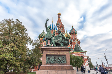 minin: Moscow, Russia - October 14, 2015: Moscow Kremlin and Red Square. Monument to Minin and Pozharsky against St. Basils Cathedral.
