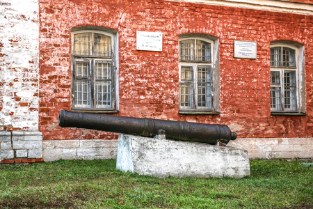 and eyelid: Pereslavl-Zalessky, Russia - November 03, 2015: Goritsky Monastery of Dormition, The museum in the building of the monastery, a pig-iron gun of the beginning of the 17th eyelid.