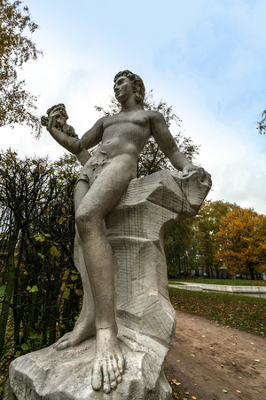 kuskovo: Moscow, Russia - October 17, 2015: Country estate of the count Pyotr Sheremetev in Kuskovo. Park sculpture of God of winemaking Bakhus.