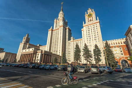 gory: Moscow, Russia - October 16, 2015: The territory of the Moscow State University on Vorobyovy Gory, MGU. The cyclist goes by university. Editorial