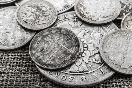 and eyelid: Silver coins of 19 and 20th eyelid of a dynasty of tsars Romanov on a sacking Stock Photo