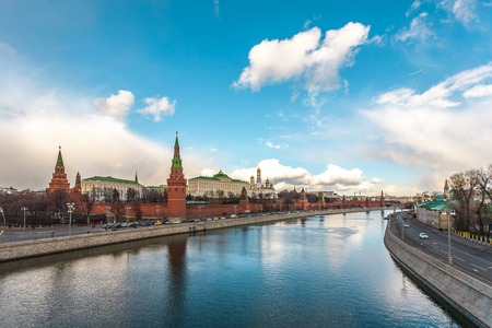 gloom: Moscow, Russia - March 11, 2016: View of the Kremlin from the Big Stone Bridge against the river embankments of Moscow. Editorial