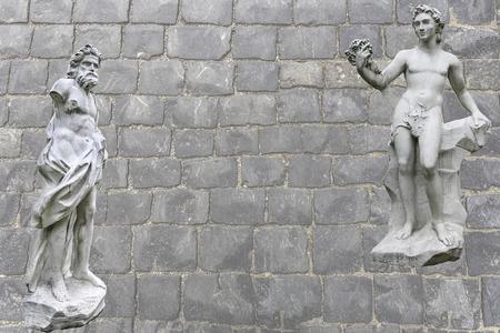kuskovo: Bacchus brings drunk Vulcanus back on Olympe. Collage on the basis of a park sculpture from Sheremetevs estate of Kuskovo.