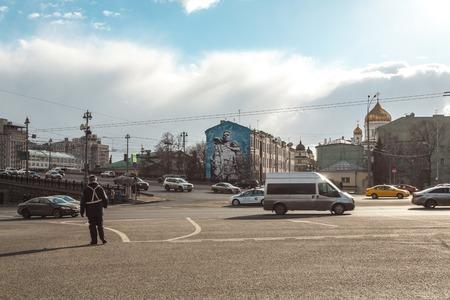traffic controller: Moscow, Russia - March 20, 2016: Kremlin traffic controller costs on descent at Bolshoy Kamenny Bridge near the Kremlin. Editorial
