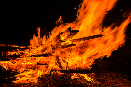 unnecessary: Burning of unnecessary old boards after dismantling of a shed Stock Photo