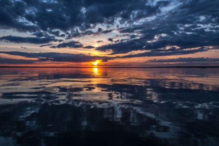 the decline: Storm clouds are reflected in water against a summer decline
