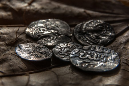 finds: Old early medieval Russian silver coins in gloomy lighting Stock Photo