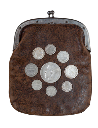 oxides: Old leather purse with silver Russian coins of the beginning of the twentieth century. Stock Photo