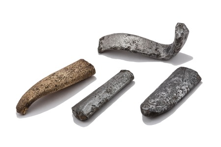 So-called jeweler ingots from archeological excavations, metal cast ingots of a different form from silver, brass and bronze with tin impurity. Stock Photo