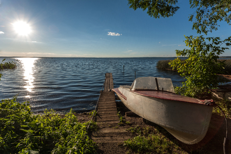 attaining: Prompt forms of the old boat attaining the age ashore. Stock Photo