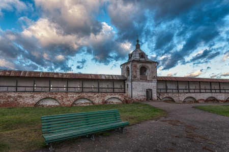 wall clouds: Goritsky Monastery wall with a watchtower in Pereslavl Zalessky in a shadow of clouds.