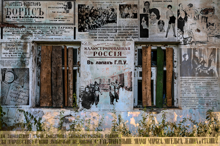 centenary: The collage of their old newspapers and magazines on a wall of the old house remembering a centenary round of the Russian history.