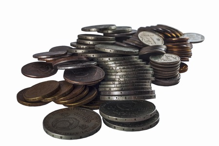 unnecessary metal coins is heaped because of inflation and low purchasing power Stock Photo