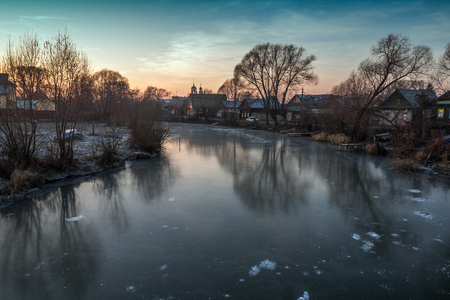 The first ice on the river Trubezh late fall at sunset.