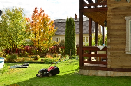 Mow the lawn, prepare the pool for winter storage, collect fallen leaves and remove from the annual flower beds - concern summer cottage garden before the winter season  photo