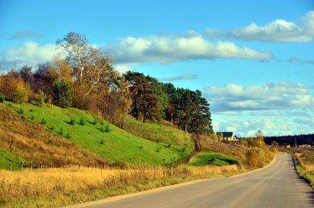 Long road along the hills - autumn landscape. Stock Photo - 15713160