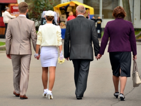 Wedding on a walk  The couple and their parents - together through life in a generation  photo