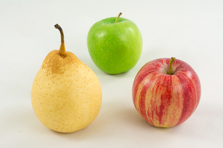 Pear and two apples on a white background photo