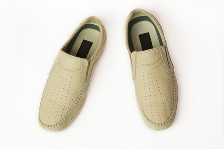 Sand summer mens moccasins on a white background