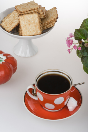 A cup of coffee, French crackers and  red oiler Stock Photo