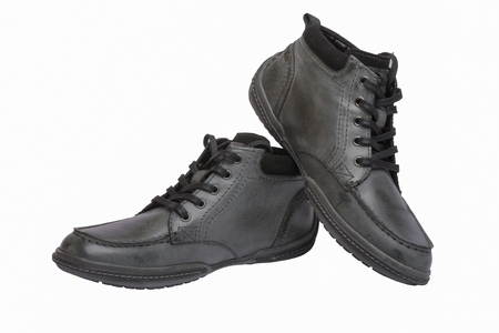 Winter mens shoes on a white background Imagens