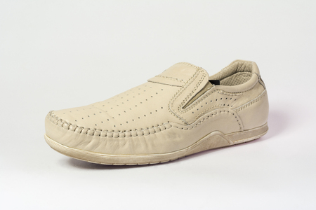 Sand summer mens moccasins on a gray background