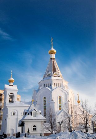 Orthodox church in the morning in the winter with snow on the roof, Russia, Tolyatti