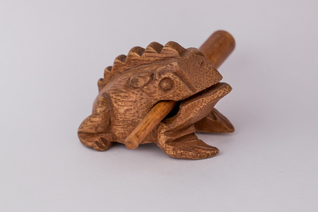 animal figurines: Wooden figurine on a white background, Frog with stick