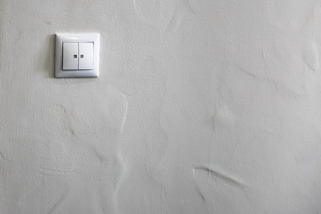 Switch on a white wall background Stock Photo