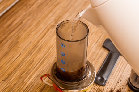 Preparation of ground coffee in aeropress - portable filter coffee maker Stock Photo