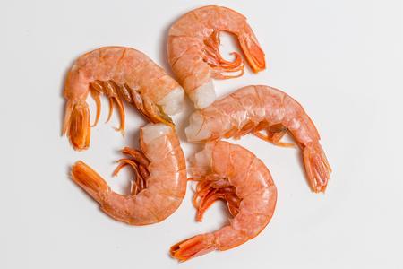 shrimp langoustine lie on a white background