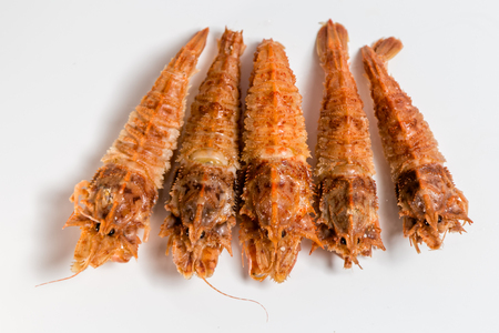shrimp langoustine lie on a white background