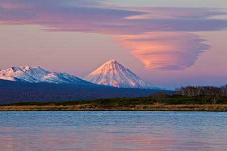 lenticular: Lenticular cloud in Kamchatka volcano and Semyachik bay