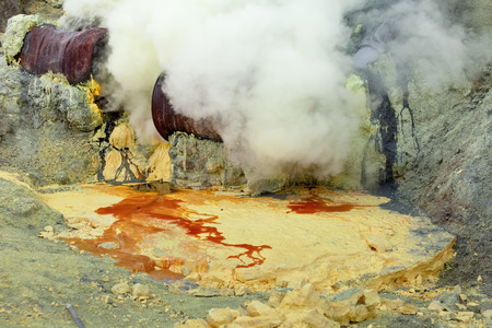 Indonesia, Java Island, February, 2010. Men work at production of sulfur in a crater of an active volcano of Kawa Ijen