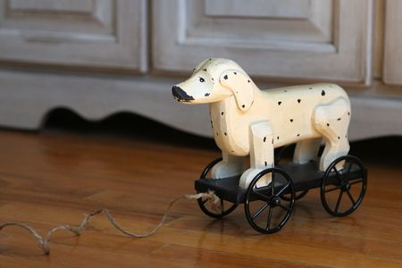 Vintage spotted toy dog with pull string on hardwood floor. Фото со стока - 485769