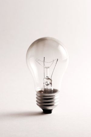 burnt out: Burnt out lightbulb on white background. Stock Photo