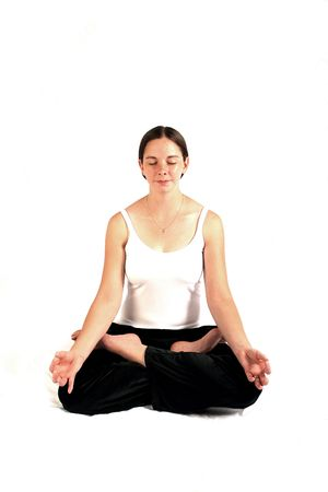 transcend: Young woman in workout clothing in yoga position. Stock Photo