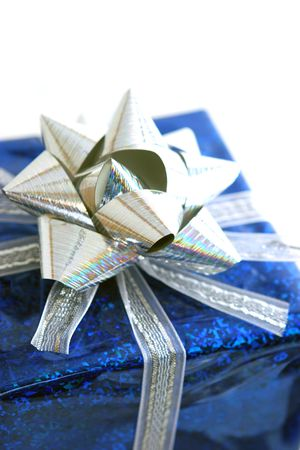 Close up of a package wrapped in blue with silver trim.