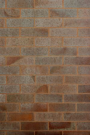 durable: reddish brown brick walll for background