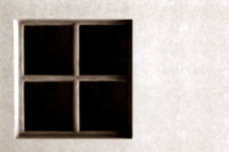 sepia image of a window in a wall, defocused to be used as a background. with room for text.